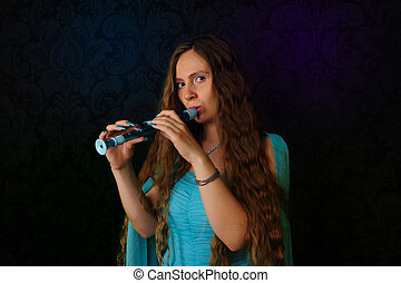 Flute player - Young flute player in beautiful blue dress