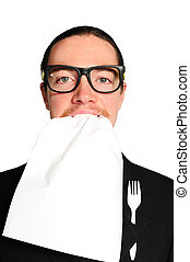 Hungry businessman eating paper