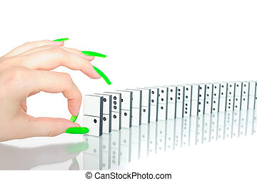 Snapping the dominoes - Woman's hand with glamour nails...