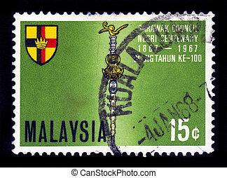 Coat of arms of Sarawak - MALAYSIA - CIRCA 1967: A stamp...