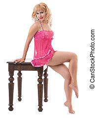 Sexy blonde in pink lingerie - portrait of a young woman in...