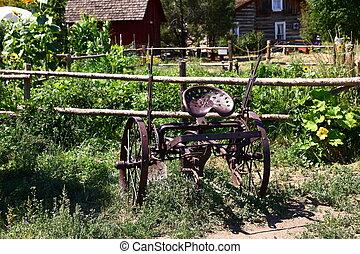 Old Metal Plow in a Garden