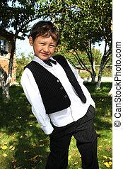 kid in fall garden