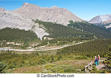 Elderly couple watching the amazing scenery of the Canadian Rocky Mountains