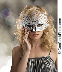 blonde girl with silver mask on the face