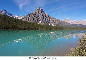 View on Hector Lake with a mountain reflecting in the quiet...