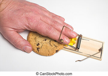 Diet Plan - A hand caught trying to get a cookie from a...