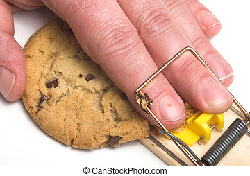 Diet Plan - A hand caught in a mousetrap. Dieting concept.