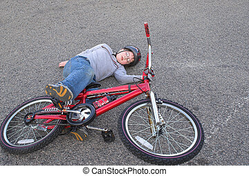 Bike Wreck - A young boy who crashed his bike.