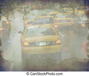 Manhattan taxi cabs during rain - Grunge defocused Manhattan...