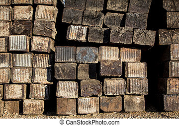 Stacked Railroad Ties Near the Side of the Tracks