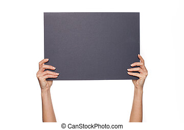 Woman's arms holding chalkboard - Cropped shot of extend...
