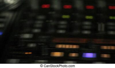Moving pan of DJ decks - Moving closeup pan of DJ decks with...