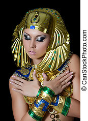 The girl-dancer in a costume of the Pharaoh - The...