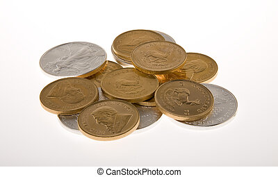 Gold and Silver Coins - One Ounce gold Krugerrand coins from...