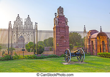Gates with canon at entrance to House of Parliament, Delhi,...