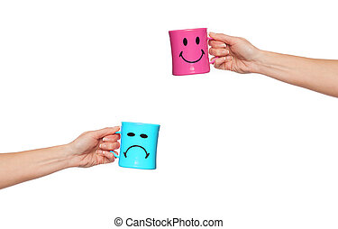 Happy mug, sad mug - Two extended female arms holding coffee...