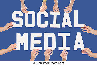 Social Media concept over blue - Studio shot of female hands...