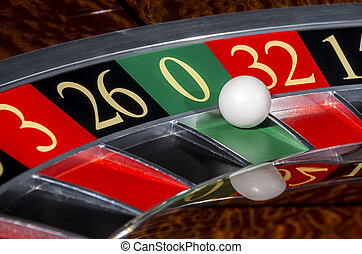 Classic casino roulette wheel with sector zero and white...