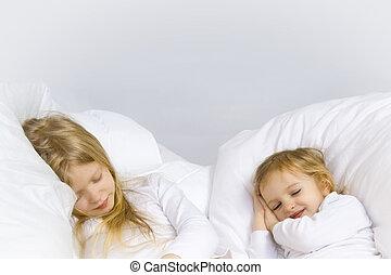 Bedtime - Little blond girl wearing white blouse in white...