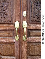 Door handles with an old double door