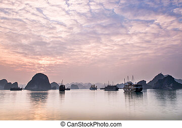 Halong Bay, Vietnam is only accessible by boat, and is made...