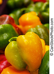 Green and Yellow Bell Peppers at the farmers market with...