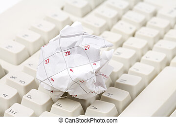 Calendar paper ball and computer keyboard - Calendar paper...