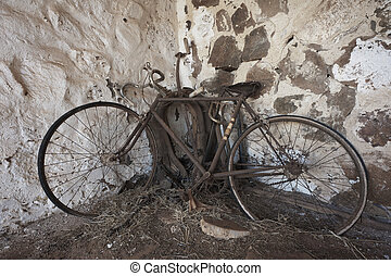 Old Rusty Bicycle - An old rusty bicycle propped up in the...