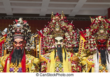 chinese god puppets - man-size puppets or costumes worn by...