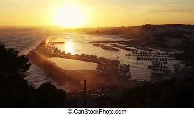 Beautiful view of the sunset over the bay of Santa Maria di...