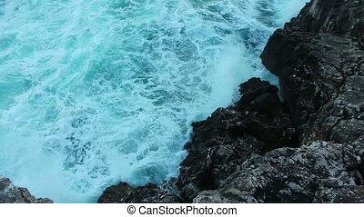 Ocean waves smashing the rocks