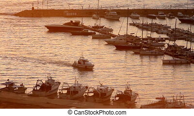 White Motor Boat Arriving at marina of Santa Maria di Leuca at sunset