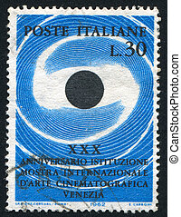 Stylized camera eye - ITALY - CIRCA 1962: stamp printed by...
