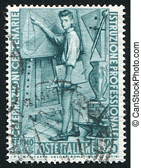 Young man at drawing board - ITALY - CIRCA 1955: stamp...