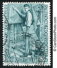 Young man at drawing board - ITALY - CIRCA 1955: stamp...
