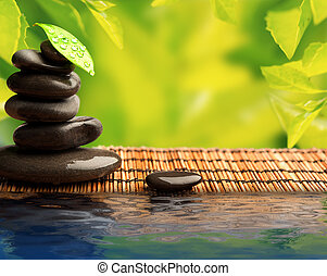green eco background with spa stones and leaves with water...