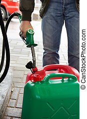 Man in jeans gas station in a plastic gasoline canister 98E