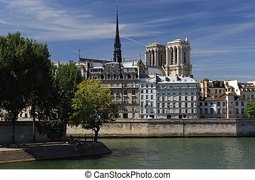 Notre Dame de Paris on Cite through the river Seine