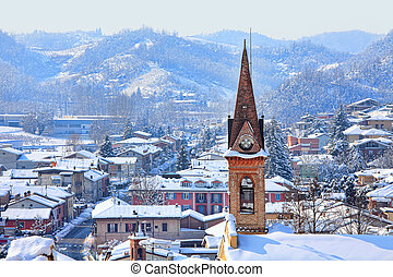Small town covered with snow. Piedmont, Italy. - Aerial view...