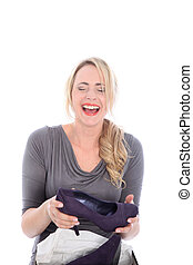 Excited Blonde Woman Opening Shoe Box - Excited happy blonde...