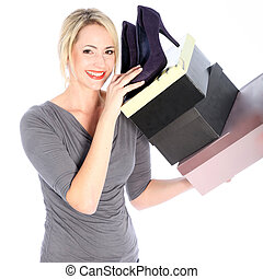 Blonde Woman Holding Boxes of Shoes - Smiling blonde woman...