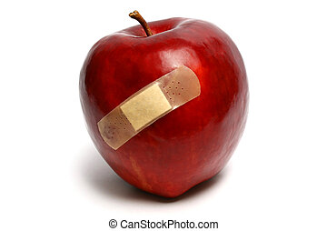 Injured Red Apple - An injured red apple with plaster on it.