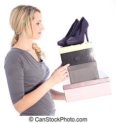 Happy Blonde Woman Holding Boxes of Shoes - Smiling blonde...