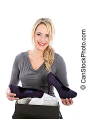 Blonde woman loves her new shoes - Blonde woman smiles as...