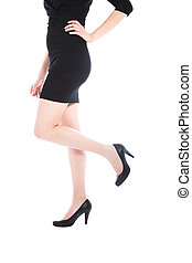Female body and legs in black dress and shoes - A studio...