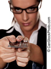 Paying by credit card - A businesswoman holding a credit...