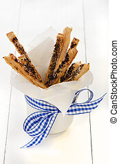 puff pretzel sticks - spicy puff pretzel sticks in a white...