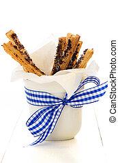 puff pretzel sticks - spicy puff pretzel sticks in a white...