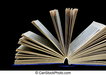 book on a black background - close-up